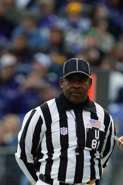 Referee Gerald Austin (R) and Umpire Roy Ellison (L) talk during a game between the Baltimore Ravens the San Fransisco 49ers in 2003.
