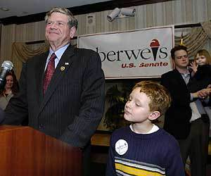 Keep your chin up U.S. Senate Republican candidate Jim Oberweis gives his concession speech in a Lisle hotel in 2004 as his grandson Timothy Oberweis looks on.