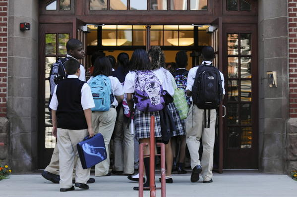 Students enter Capital Preparatory Magnet School in Hartford. Known for summer classes and strict discipline, the school is one of many opened to bring school equity to city students.