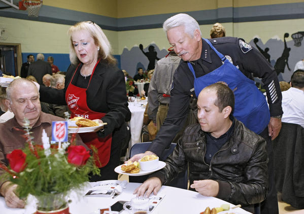 Outgoing Glendale police chief Ron DePompa, right, helped serve breakfast for others at the 5th annual Kettle Kick Off Breakfast at the Salvation Army Glendale Corps Community Center in Glendale on Friday, Nov. 22, 2013.