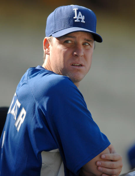 Dodgers hitting coach Bill Mueller watches batting practice before a game in 2007.