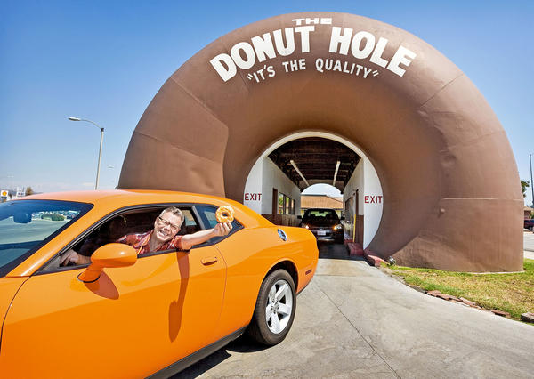 Pop culture humorist Charles Phoenix at the Donut Hole drive-through in La Puente. Phoenix will explore Southern California's idiosyncratic mid-20th century architecture on Sunday, Nov. 24 at Art Center College of Design in Pasadena.