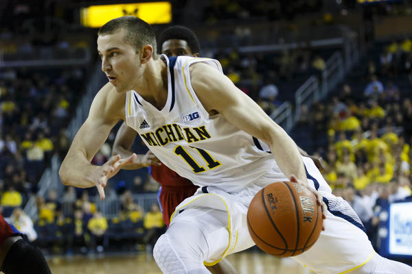 Michigan's Nik Stauskas moves the ball in the first half against South Carolina State on Nov. 13.