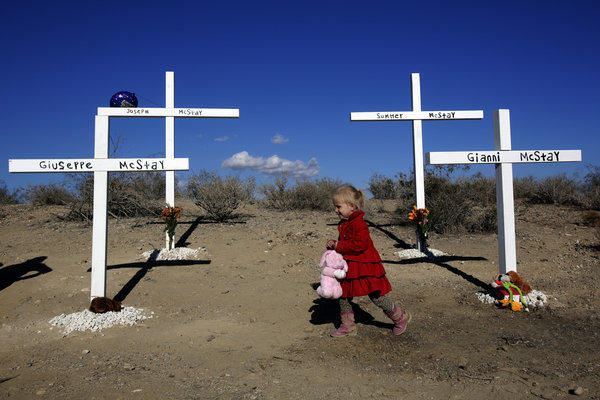 Friends and family of the McStay family, whose remains were found buried in shallow graves in the desert near Victorville, have set up crosses memorializing them.