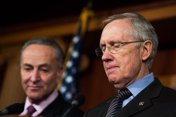 (L-R) Sen. Chuck Schumer (D-NY) and Senate Majority Leader Harry Reid (D-NV) are seen during a news conference on Capitol Hill, November 21, 2013 in Washington, DC.
