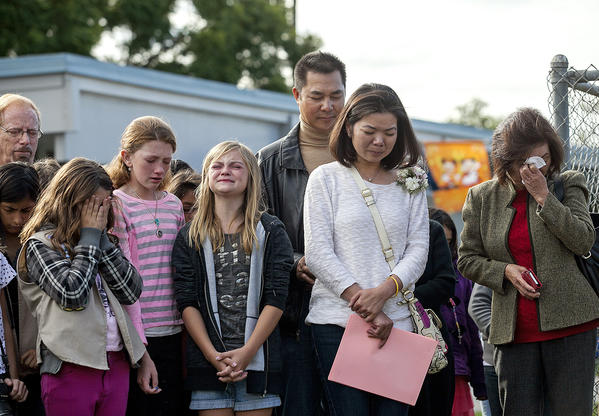 Vince and Karen Nguyen, center, and Dao Tran, the mother, father and grandmother of Samantha Nguyen, along with her friends Tristen Taber, left, Lexi Rae, and Alexa Tickenoff grieve during the dedication of a tree to honor Samantha at Sonora Elementary School on Friday, November 22. Samantha, who was a sixth grade student at the school, died in a boating accident earlier in the school year. The school also dedicated a bookshelf and bench in Samantha's name.