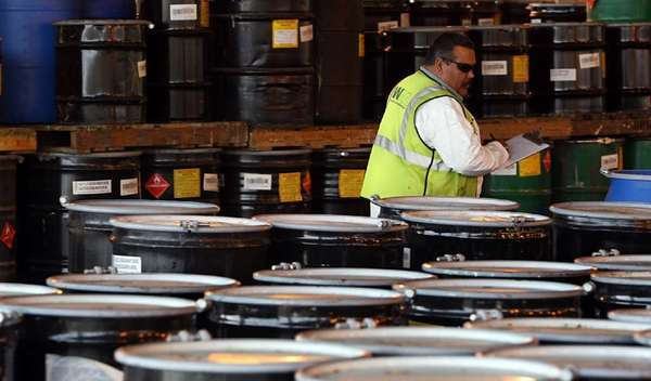 A worker takes inventory of hazardous waste stored in barrels at a Kettleman City facility licensed to accept such dangerous shipments. There are significant gaps in California's laws governing the transport and disposal of hazardous waste, an L.A. Times investigation found.