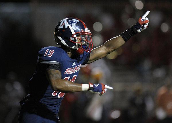 Miramar receiver Khalil Lewis celebrates scoring a touchdown during the first half against Deerfield Beach.