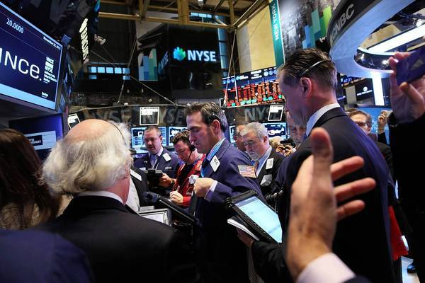 Traders work the floor of the New York Stock Exchange on Friday. The day before, newfound enthusiasm among small investors helped power the Dow Jones industrial average to its first close above 16,000.