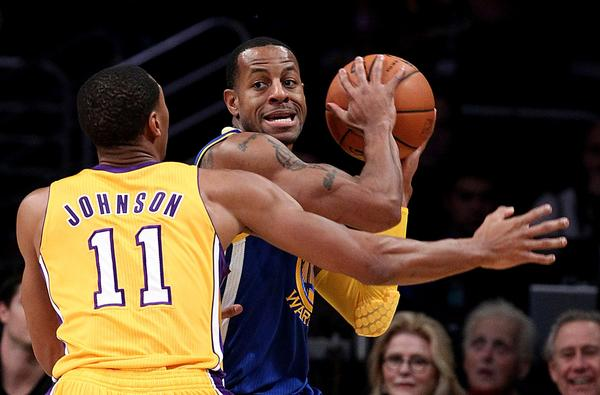 Lakers forward Wesley Johnson applies defensive pressure against Warriors forward Andre Iguodala in the first half Friday night at Staples Center.
