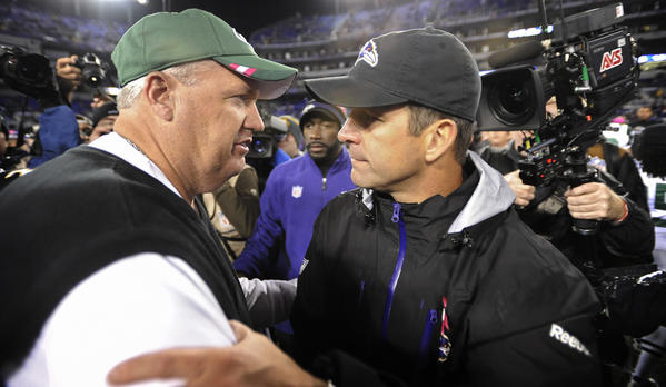 Ravens head coach John Harbaugh and New York Jets head coach Rex Ryan meet after a Ravens win at M&T Bank Stadium in 2011.