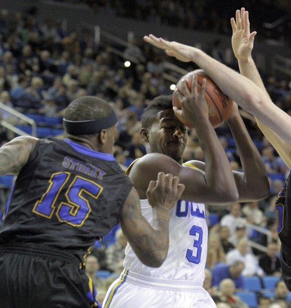 UCLA's Jordan Adams is smothered by Morehead State's defense during the first half on Nov. 22 at Pauley Pavilion.