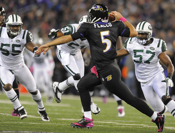 Ravens quarterback Joe Flacco throws on the run after scrambling out of the pocket during a 2011 game against the New York Jets.