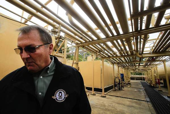 Tim Parker, vice president of operations with Allenco Energy Co., leads a tour of the company's facilities in South Los Angeles. Allenco will suspend operations pending completion of investigations into health complaints by people living near the oil field.