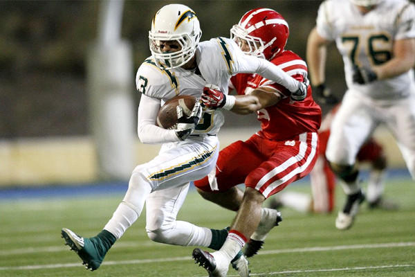 Santa Ana Mater Dei's Matthew Rockett wraps up Edison's Jeremy Maxwell in a non-league game on Sept. 27.