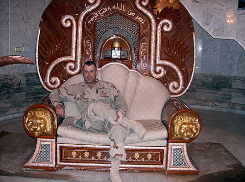 Major Web Wright on one of Saddam Hussein's throne in the Camp Victory palace complex.