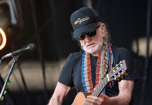 Musician Willie Nelson performs during the Oklahoma Twister Relief Concert to benefit United Way of Central Oklahoma May Tornadoes Relief Fund.