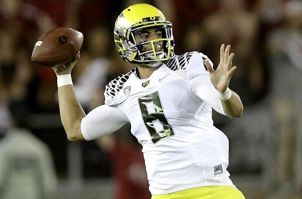 Oregon quarterback Marcus Mariota, shown against Stanford, had his threw his first pass intercepted of the season on Saturday.