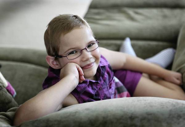 Eight-year-old Chloe Williams, pictured at home on Sept. 16, is battling multiple brain tumors. Her dad is also out of work and her family is struggling. Chloe was diagnosed with an epenymoma brain tumor in 2009.
