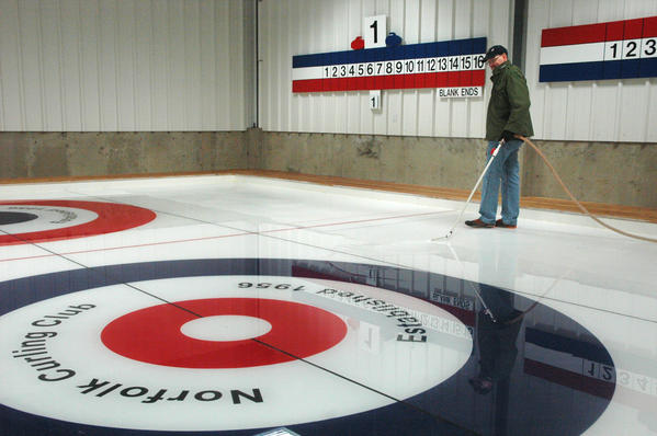 Jon Barbagallo, a longtime Norfolk Curling Club member, works on making ice at the new Norfolk Curling Club, which will celebrate its grand opening Sunday Nov. 24. The old curling club was destroyed in an arson fire in December 2011.