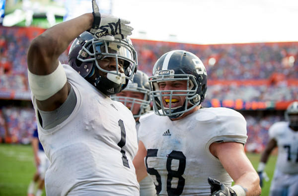 Georgia Southern quarterback Jerick McKinnon celebrates with offensive linesman Garrett Frye after scoring a touchdown against Florida on Saturday at Ben Hill Griffin Stadium.