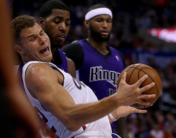 Clippers forward Blake Griffin tries to power his way to the basket against the Kings in the second quarter Saturday afternoon at Staples Center.