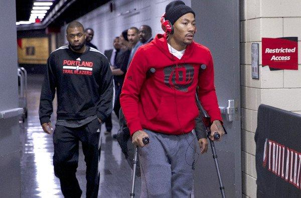 Bulls point guard Derrick Rose leaves the Moda Center in Portland on crutches after he was injured in the game against the Trail Blazers on Friday night.