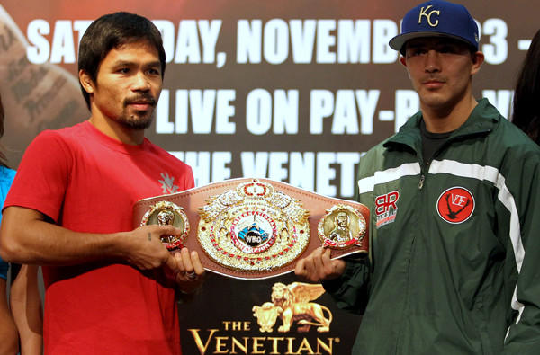 Boxer Manny Pacquiao, left, and Brandon Rios pose with the belt during a news conference in Macau on Wednesday.