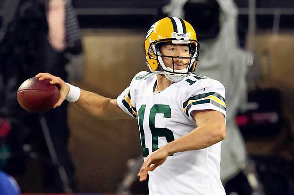 Nov 17, 2013; East Rutherford, NJ, USA; Green Bay Packers quarterback Scott Tolzien (16) drops back to pass against the New York Giants during the first quarter of a game at MetLife Stadium.