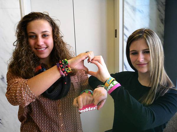 "Easton Area School District students Kayla Martinez (left), 14, and Brianna Hawk, 15, won a court appeal, allowing them to wear breast-cancer awareness bracelets with the word ""boobies"" on them. But the district may ask the Supreme Court to overturn the ruling."
