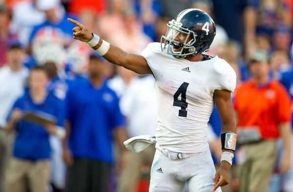 Quarterback Kevin Ellison points to a teammate after Georgia Southern scored a touchdown against Florida on Saturday.