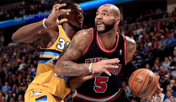 Chicago's Carlos Boozer works his way to the basket against Denver's Kenneth Faried on Nov. 21.