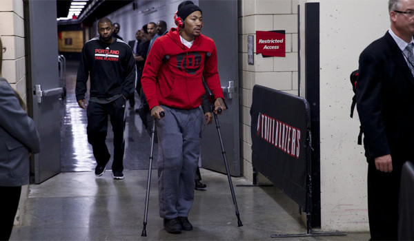 Chicago point guard Derrick Rose leaves the Moda Center on crutches Friday after he was injured during a game against the Portland Trail Blazers.