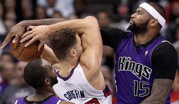 Sacramento's DeMarcus Cousins fouls the Clippers' Blake Griffin on Saturday.