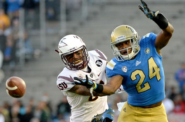 UCLA defensive back Ishmael Adams breaks up a pass intended for Arizona State receiver Jaelen Strong in the first quarter Saturday at Rose Bowl.