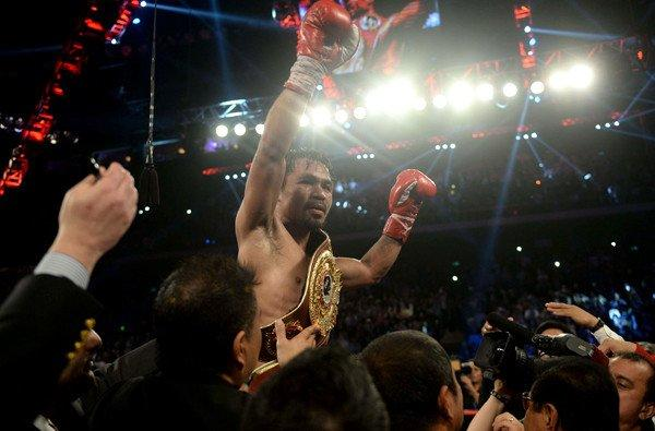 Manny Pacquiao celebrates after defeating Brandon Rios by unanimous decision in their welterweight fight on Sunday in Macau.