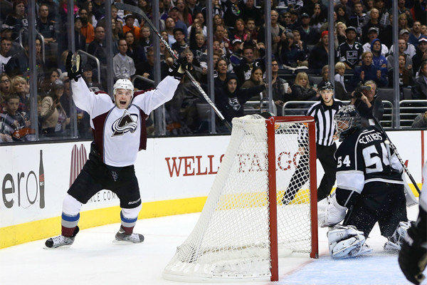 Colorado's Jamie McGinn celebrates after scoring the game-winning goal in overtime against Kings goaltender Ben Scrivens at Staples Center on Saturday.