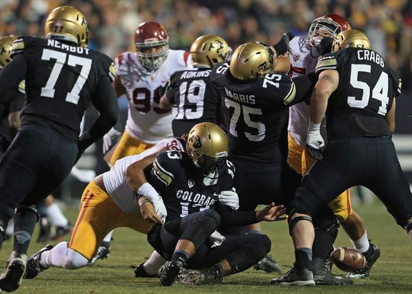 Colorado quarterback Sefo Liufau fumbles while being sacked by USC's Leonard Williams during the second quarter Saturday in Boulder.