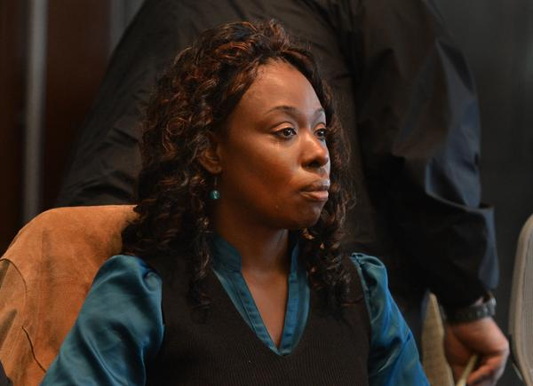 Crystal Mangum sits in court Friday during the reading of the jury's verdict finding her guilty of second-degree murder in the stabbing death of her boyfriend in 2011.