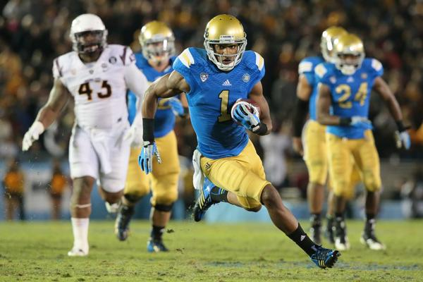 UCLA receiver Shaquelle Evans turns upfield on a 27-yard touchdown pass play to cut the Bruins' deficit against Arizona State to 38-33 in the fourth quarter.