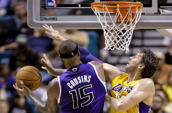 Lakers power forward Pau Gasol tries to block a shot by Kings center DeMarcus Cousins during a preseason game in Las Vegas.