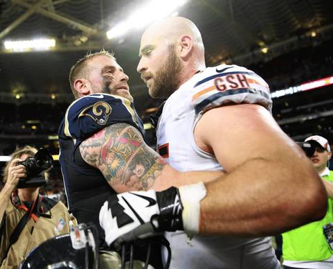 Chris Long of the Rams hugs his little brother, Kyle Long of the Bears, after the game.