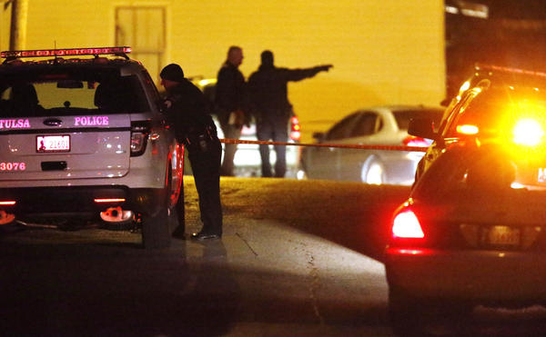 Police in Tulsa, Okla., investigate a shooting at a home Saturday night that left four people dead and one wounded.