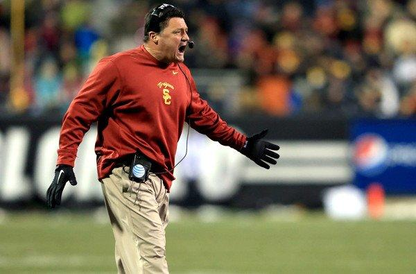USC interim Coach Ed Orgeron fires up the Trojans during their game against Colorado on Saturday.