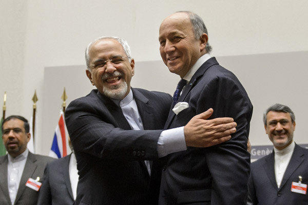 Iranian Foreign Minister Mohammad Javad Zarif, left, and French Foreign Minister Laurent Fabius embrace after a landmark deal to limit Iran's nuclear program is announced.
