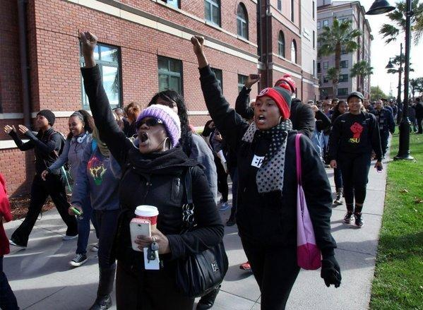 Champagne Ellison, left, a senior at San Jose State University, marches during a protest this month over reported racial hazing of an African American freshman by his dormitory roommates.