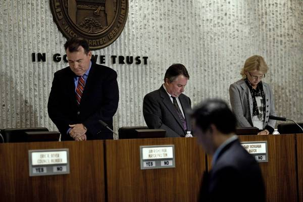 Costa Mesa City Council Members Jim Righeimer, Gary Monahan and Wendy Lee at a meeting in May 2011.