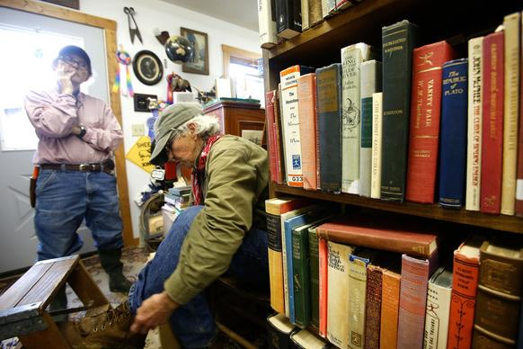 Lynda German, right, and Polly Hinds own Mad Dog and the Pilgrim, a bookstore in Sweetwater Station, Wyo. The longtime partners moved from Denver and bought a ranch, where they sell books out of their two-story barn.
