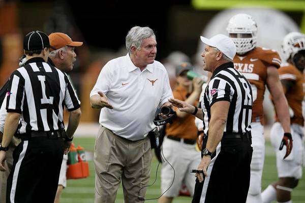 Head coach Mack Brown of the Texas Longhorns argues a roughing-the-kicker penalty against the Oklahoma State Cowboys during the second half at Royal Memorial Stadium in Austin, Texas.
