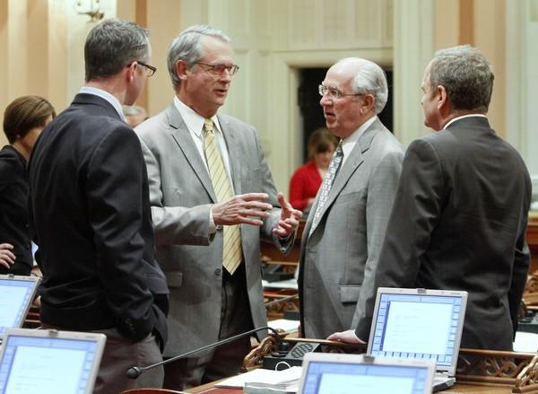 State Sen. Bill Emmerson, second from left, has decided to leave the Legislature, saying that his passion has waned. Officials estimate that a special election will cost $1.1 million.